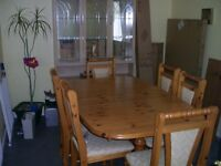 solid wood 6 seat extending table can seat at least ten or more