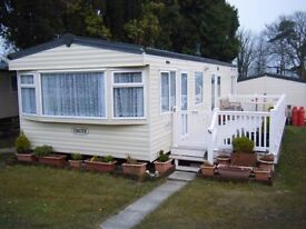 Lovely 2 bed caravan including decking and shed on a quiet, family run, rural tree lined site.