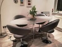 Glass oval modern dining table and 4 matching chairs (Dwell)