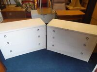 2 low but wide chest of drawers.