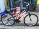 mans red and black duel suspension 18 inch frame olympus bike with lock