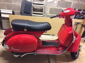 Rare red retro Vespa. Mint condition. One owner. Exceptionally low mileage. Garaged.