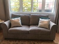 Two-seater sofa bed (only 14 months old!) barely used and in perfect conditions.