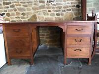 Beautiful solid wood desk. Six drawers. 35 inch x 60 inch top 30 inch height.