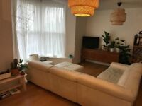 2008 DFS cream leather corner sofa (left hand facing) and pouffe