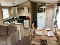 Superb static caravan, with a side decking. Cheap fees, and fishing lakes at White Acres, Newquay