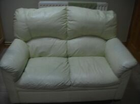 CREAM LEATHER 2 SEATER.CHEAP FOR QUICK SALE.