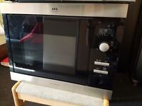 intergrated contamporary aeg microwave (was £400, now £40) germany made. Delivery