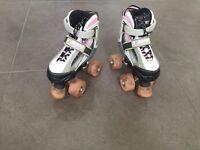 SFR Typhoon Pink Adjustable Quad Roller Skates . Shoe size 8-11