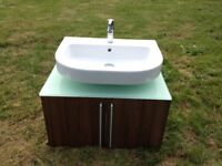 Modern contemporary white sink basin & tap with wall mounted wood unit & glass top, bathroom fixture