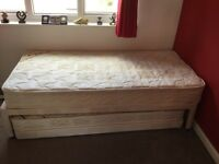 Single bed with pull out bed underneath