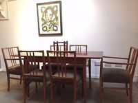 Gordon Russell designed dining room set. Tulip wood table, 4 chairs and 2 carvers. Seats 6