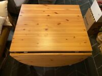 "IKEA ""Gamleby"" gateleg dining table and two matching chairs"