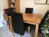 Extendable solid oak table & 6 chairs