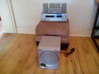 Home cinema system.(Sony)receiver .5speakers BBC plus base speaker.