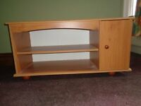 Cabinet for TV or similiar. Teak veneered with centre shelf and cupboard with internal shelf