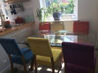 Glass dining room table plus 8 beautiful coloured chairs