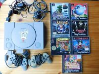 PlayStation 1 classic PS1 console, 2 controllers and 8 games - £30
