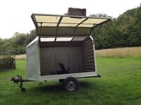Lightweight covered 2 wheel trailer. 6feet x 4feet base. Complete with jockey wheel and trailerboard