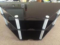 Three-tier brush steel and black glass television stand