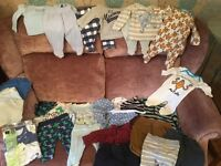 Bundle baby boys up to 1month, sleepsuits, pyjamas sets, vest, hats ,trousers.
