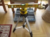 Lazer type spirit level on tripod unused, boxed complete with instruction manual