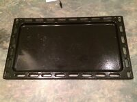 Enamelled cooker tray