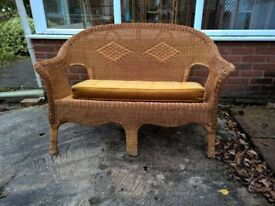 Cane Settee with long cushion. ideal conservatory, bedroom, garden