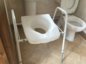 Standard size toilet frame and seat preowned.