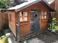 Wooden playhouse with carpet and curtains8x6 buyer to dismantle and collect