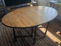 Drop leaf dining table, oval-shaped
