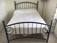 Dark metal framed double bed frame