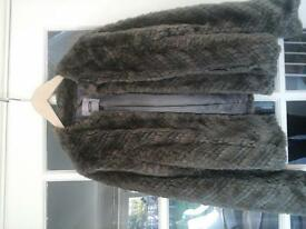 Faux fur jacket , taupe, brown shades.