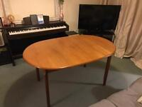 Sturdy solid wood expandable family dining table.