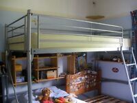 High metal bunk bed with desk below. Ladder and mattress. Good condition