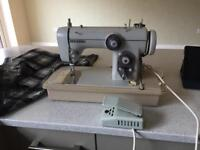 Janome New Home sewing machine with instructions