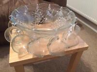 Glass punch bowl and 12 glasses with hooks and a plastic ladle