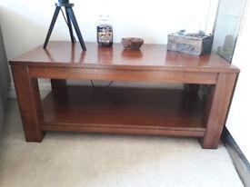 Dark hardwood coffee table and sideboard