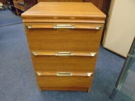 small bed side cabinet with gold handles.