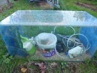 Fish tank 45cmx45cmx90cm long.approx. 130 litres capacity. bags of fish food and 2 filter pumps