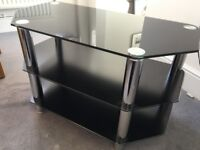 TV stand - black glass with chrome legs. 80cm x 42cm x 50cm.