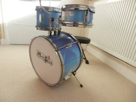 Childs three piece drum set includes two tom-toms, one bass drum and cymbal