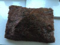 Brown fake fur cushions