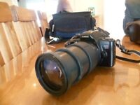 Two Cannon slr cameras and a Pansonic camcorder