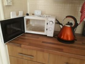 Orange, black, and silver kettle - 1.8litre - any offer considered