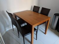 Solid wood walnut 117cm dining table and 4 chairs in brown faux leather with metal frame and legs