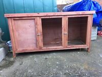 Rabbit hutch with thermal cover