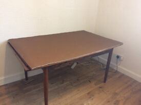 Large solid oak extendable table with protective mat