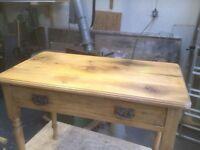Small antique pine desk with Art Nouveau handles.
