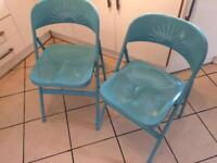 Two IKEA frode folding chairs